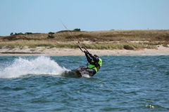 Kite surfer. Down low in water making waves Royalty Free Stock Photography
