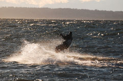Kite surfer enjoying the speed and the sun Royalty Free Stock Photos