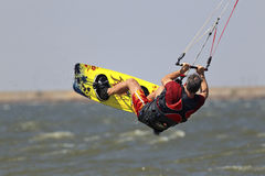 Kite surfer getting some air. Kite surfer hanging in the air above water Royalty Free Stock Images