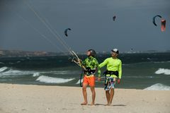 Kite surfer with his learner Stock Photo