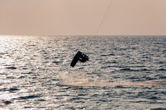 Kite surfer jumping from the water Royalty Free Stock Photography
