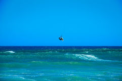 Kite surfer jumping from the water. Kite surfer jumping wave in Cape Town, South Africa Stock Photography