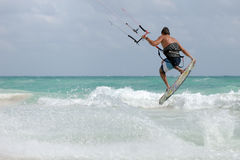 Kite surfer jumping wave. In Caribbean ocean Royalty Free Stock Images