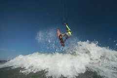 Kite surfer. A kite surfer rides the waves Royalty Free Stock Photography