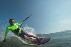Kite surfer. A kite surfer rides the waves Stock Photos