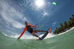 Kite surfer. A kite surfer rides the waves Royalty Free Stock Image