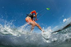 Kite surfer. A kite surfer rides the waves Stock Photography