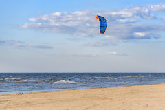 Kite surfer making tricks nea Baltic sea coast line at Riga, Latvia Royalty Free Stock Image