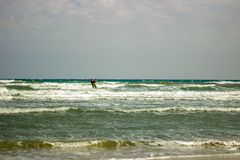 Kite Surfer in the Mediterrean Sea on an Autumn windy day royalty free stock images