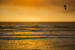 Kite Surfer in Orange Sunset Stock Photos