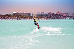 Kite surfer on Palm Beach at Aruba island in the Caribbean at su. Nset Stock Photos