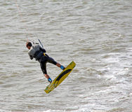 Kite surfer performing stunts. Photo of a male kite surfer performing out of water stunts on the coast of whitstable in kent england.photo taken 17th june 2014 royalty free stock image