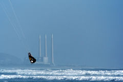Kite Surfer and Power Plant Royalty Free Stock Image