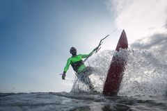 Kite surfer. A kite surfer rides the waves Stock Image