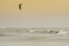 Kite surfer rides among the waves Royalty Free Stock Photos