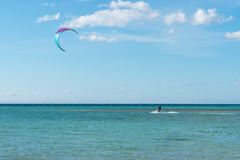 A kite surfer rides the waves stock image
