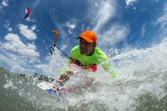 Kite surfer. A kite surfer rides the waves Royalty Free Stock Photos