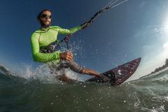 Kite surfer. A kite surfer rides the waves Royalty Free Stock Photo