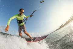 Kite surfer. A kite surfer rides the waves Royalty Free Stock Images