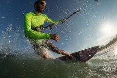 Kite surfer. A kite surfer rides the waves Stock Images