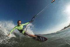 Kite surfer. A kite surfer rides the waves Stock Photo
