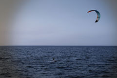 Kite surfer rides on the waves under parachute Royalty Free Stock Photography
