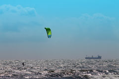 Kite surfer in rough sea and blue sky Royalty Free Stock Images