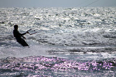 Kite surfer in rough sea Royalty Free Stock Photos