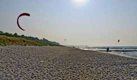 Kite surfer at the sandy beach Royalty Free Stock Photo