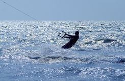 Kite surfer in sea. Side view of silhouetted kite surfer in sea Stock Photo