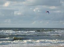 Kite surfer at sea stock photos
