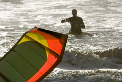 Kite Surfer Silhouette. A kite surfer and his colorful kite are silhouetted against the ocean Stock Photography