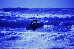 Kite surfer silhouette on blue sky background Royalty Free Stock Photography