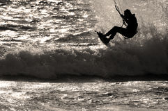 Kite Surfer Sillhouette. Kite sufer at Sunset Beach jumping wave in sillhouette Royalty Free Stock Images