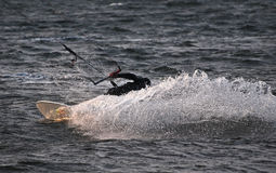 Kite surfer spraying water making a move. On Puget Sound Stock Image