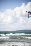 Kite surfer on storm waves Royalty Free Stock Photo