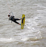 Kite surfer stunts at sea Stock Image