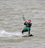 Kite surfer stunts at sea Royalty Free Stock Images
