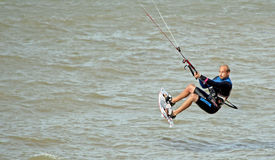 Kite surfer stunts at sea. Photo of a male kite surfer performing stunts at sea off the coast of whitstable in kent on 17th june 2014.photo ideal for kite royalty free stock photos