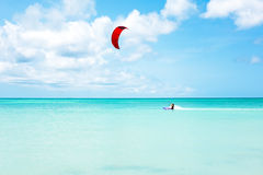Kite surfer surfing on the Caribbean Sea at Aruba. Island royalty free stock photo