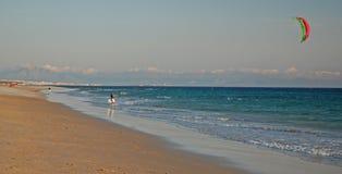 Kite-surfer in Tarifa. Kite-surfer on a beach in Tarifa, Spain Stock Images