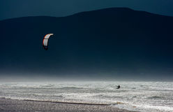 Kite Surfer in the Waves at the Coast of Ireland Stock Photos