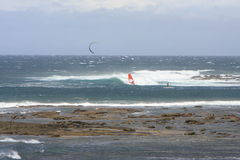 Kite surfer and wind surfer Royalty Free Stock Images