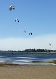 Kite surfers. Five kite surfers form an arch with their kites as they enjoy their Sunday on the water stock photos