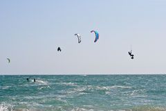 Kite surfers on a choppy sea Royalty Free Stock Images