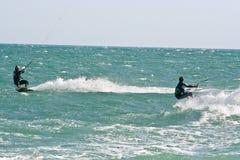Kite surfers on a choppy sea Royalty Free Stock Image