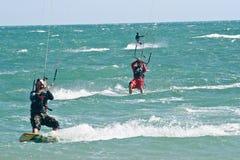 Kite surfers on a choppy sea Royalty Free Stock Photography