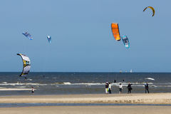 Kite Surfers. Enjoying a sunny and windy day near the famous coastal town of Scheveningen, the Netherlands Stock Image