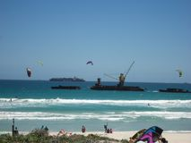 Kite surfers off the coast of Blouberstrand, South Africa royalty free stock photography