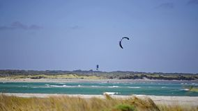 Kite Surfers out in the Surf, at the Mouth of the Blackwood River, Augusta. royalty free stock image